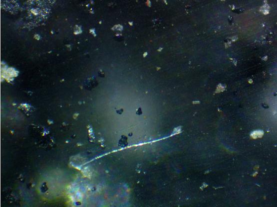 частицы золы, атмосферной пыли и кристаллы нитрата аммония